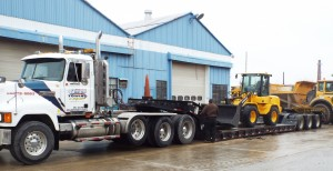 Heavy Equipment experts from McClung-Logan transport construction equipment
